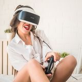 Technology, augmented reality, cyberspace, entertainment and people concept - happy young woman wearing virtual headset. Or 3d glasses with exotic tropical Royalty Free Stock Image
