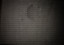 Technology background. With  perforated carbon aluminum grill texture Royalty Free Stock Photos
