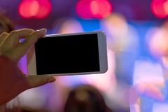 Technology background hand hold mobile phone with copy space bla. Ck screen for photography. image for light up, christmas, festival, event, bulb, decoration Royalty Free Stock Photos