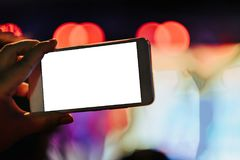 Technology background hand hold mobile phone with copy space whi. Te screen for photography. image for light up, christmas, festival, event, bulb, decoration Stock Photos