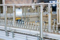 Technology bottling plant for bottles. New bottling plant for glass bottles Royalty Free Stock Image