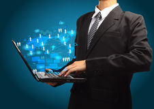 Technology business concept on computer laptop in the hands Stock Photography