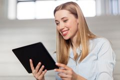 Woman or student with tablet pc at office Stock Image