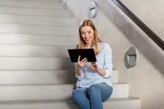 Woman or student with tablet pc sitting on stairs Stock Images