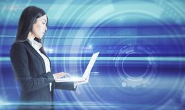 Technology and communication concept. E view of attractive young european businesswoman using laptop on blurry background. Technology and communication concept stock photos