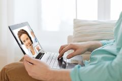 Man having video call with helpline operator stock photos