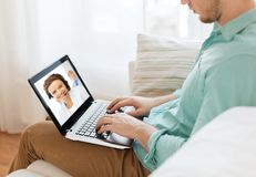 Man having video call with helpline operator stock image