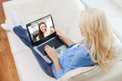 Woman having video call on laptop at home royalty free stock photos