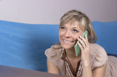 Technology, communication - happy young woman calling on smartph Royalty Free Stock Photos