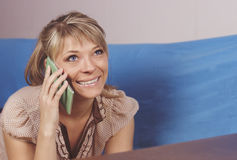 Technology, communication - happy young woman calling on smartphone and laughing at home Stock Photography