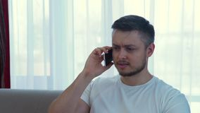 Technology communication irritated annoyed angry. Technology communication. irritated annoyed angry adult caucasian man ending an unpleasant phone call stock footage