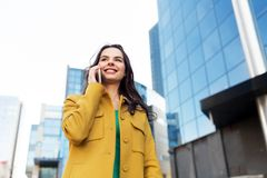 Smiling young woman or girl calling on smartphone royalty free stock image