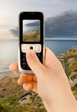 Technology communication phone. A technology cellular phone holding in a human hand Stock Images