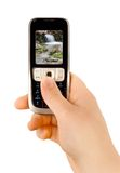 Technology communication phone. A technology cellular phone holding in a human hand Royalty Free Stock Image