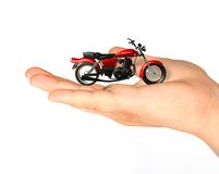 Technology concept. Close up hand with a motorcycle concept Stock Photography