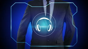 Technology concept - businessman pressing headphones button on virtual screens. Technology, internet and networking concept - businessman pressing service button stock footage