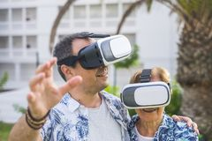 Technology concept for no young people middle age and mature man and woman enjoying the outdoor leisure activity with virtual. Technology concept for no young stock photography