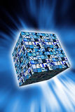 Technology cube. Cube with technology images on a blue background with light beams Stock Image