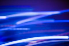 Neon lights background, abstract lines in motion. Technology, defocused textures and futuristic design concept - Neon lights background, abstract lines in motion royalty free stock photo