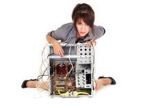 Technology despair. Hopeless woman and her broken computer Stock Images