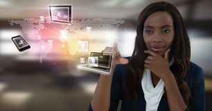 Technology devices interface and Businesswoman touching air in front of office windows. Digital composite of Technology devices interface and Businesswoman Stock Images