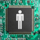 Technology driven society. Concept with a man icon imprinted on a computer chip Stock Images