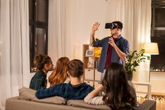 Man in vr glasses at home with friends stock photo