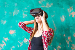 Technology, entertainment and people concept - happy young woman with virtual reality headset or 3d glasses Stock Photo