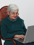 Technology is for everyone. Close-up image of a senior woman using a laptop Royalty Free Stock Images
