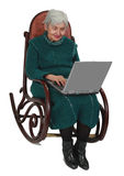 Technology is for everyone. Image of a senior woman using a laptop while sitting in a rocker Stock Photo
