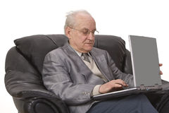 Technology is for everyone. Close-up image of a senior man using a laptop.Shot with Canon 70-200mm f/2.8L IS USM Royalty Free Stock Photo