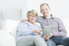 Technology is for everyone. Portrait of a happy young men and his grandmother holding a tablet Royalty Free Stock Photo