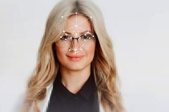 The technology of facial recognition. Portrait of beautiful blonde royalty free stock photos