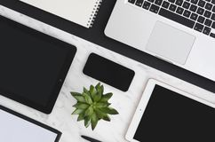 Technology flat lay. Workplace with office tools and gadget laptop, digital tablets and smartphone develop applications royalty free stock photography