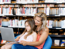 Technology and fun in the library Royalty Free Stock Photo