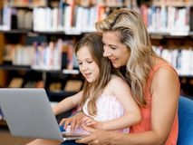 Technology and fun in the library Royalty Free Stock Image