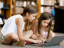 Technology and fun in the library Stock Image