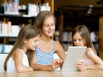 Technology and fun in the library Stock Photography