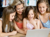 Technology and fun in the library Royalty Free Stock Photos