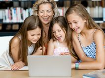 Technology and fun in the library Royalty Free Stock Photography
