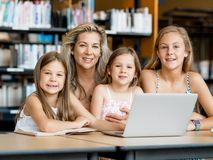 Technology and fun in the library Royalty Free Stock Images