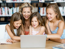 Technology and fun in the library Stock Images