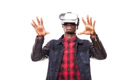 Technology, gaming, entertainment and people concept. African man wearing formal suit and virtual reality headset or 3d glasses, p stock photography