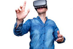 Technology, gaming, entertainment and people concept. Man wearing formal suit and virtual reality headset or 3d glasses, playing. Video game, gesturing with his stock image