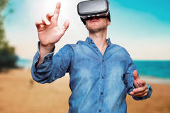 Technology, gaming, entertainment and people concept. Man wearing formal suit and virtual reality headset or 3d glasses, playing. Video game, gesturing with his stock photography