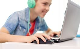 Boy in headphones playing video game on laptop Stock Photography