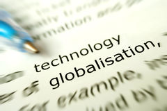 Technology for globalisation concept. A conceptual photograph of the words technology and globalization on a book. With pen pointing to words. concept for stock photography