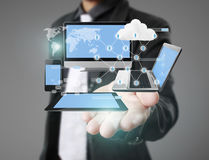Technology in  hands of businessmen Stock Photo