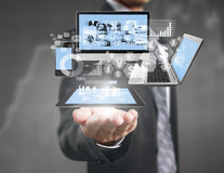 Technology in  hands of businessmen Stock Photography