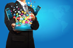 Technology in the hands of businessmen. Creative design Stock Photography